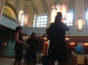 Violin 1, Violin 2, Viola performing with tracks